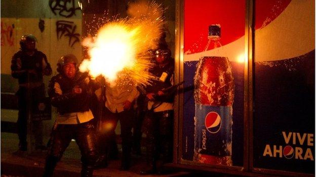 Security officer fires tear gas in Caracas, Venezuela