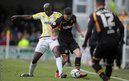 Torquay's Enoch Showunmi challenges Newport County defender Andrew Hughes in the League Two game at Plainmoor.