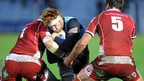 Glasgow flanker Rob Harley crashes into Scarlets forwards Phil John and Johan Snyman
