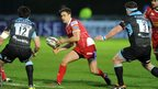 Scarlets fly-half Aled Thomas offloads the ball under pressure during his side's 14-6 Pro12 defeat away to Glasgow.