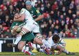 Leicester fly-half Owen Williams is high tackled by Exeter's Dean Mumm in the he Aviva Premiership match at Welford Road
