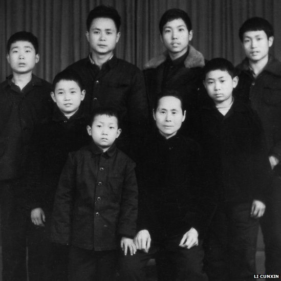Li at age 10 with his mother and brothers