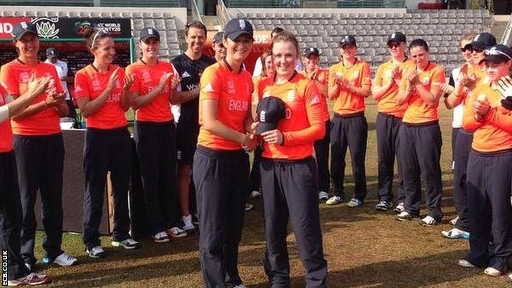 Rebecca Grundy receives her England cap from Charlotte Edwards