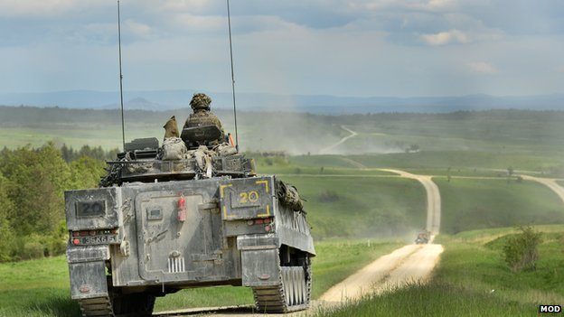 A British Warrior Armoured Infantry Fighting vehicle patrols down the live firing range in Grafenwöhr, Germany