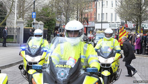 A police escort escorted the hearse to the cathedral