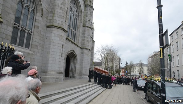 Coffin being brought into church