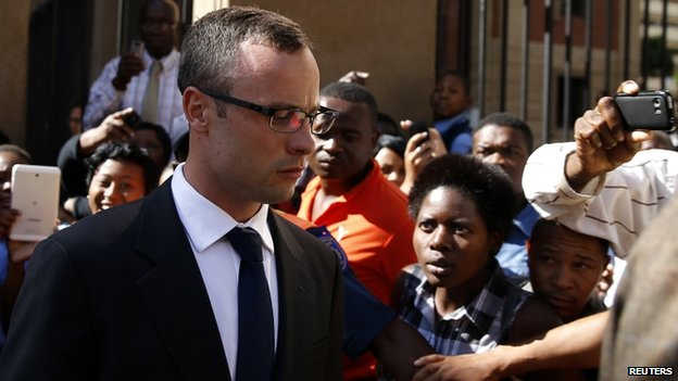 Oscar Pistorius leaves after his trial for the murder of his girlfriend Reeva Steenkamp, in Pretoria, on 24 March 2014