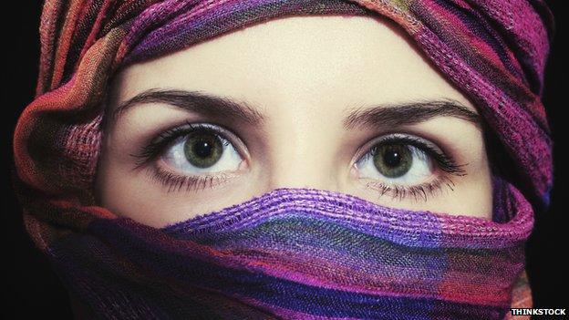 A woman wearing a headscarf