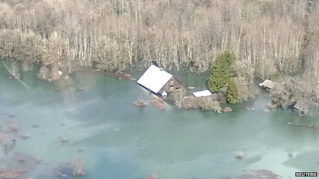 An aerial view of the area affected by a landslide near State Route 530 near Oso, Washington, on 23 March 2014
