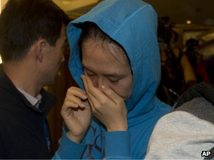 A relative of a Chinese passenger aboard the Malaysia Airlines MH370, cries after being told the latest update in Beijing, China, on 24 March 2014.