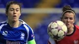 Birmingham City's Karen Carney chests the ball away from Arsenal's Emma Mitchell