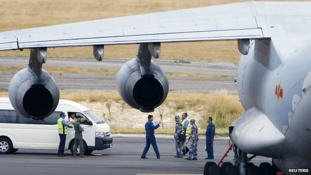 The crew of one of two Chinese Air Force Ilyushin Il-76 aircrafts used in the search for flight MH370 on the tarmac in Perth on 25 March 2014