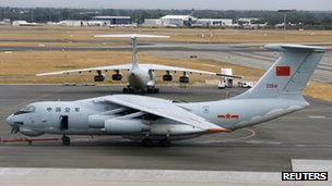 Two Chinese Air Force Ilyushin Il-76 aircrafts used in the search for Malaysia Airlines flight MH370 are towed on the tarmac of Perth International Airport, Australia, 25 March 2014
