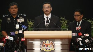Malaysia's acting Transport Minister Hishammuddin Hussein (C) speaks about the search for the missing Malaysia Airlines Flight MH370, during a news conference at the Putra World Trade Center in Kuala Lumpur 25 March 2014. Satellite data that confirmed a Malaysian jetliner missing for more than two weeks crashed in the Indian Ocean included a final electronic signal that is still being investigated, Hishammuddin said on Tuesday. Seen on left is police chief Inspector General Khalid Bin Abu Bakar and on right is Department of Civil Aviation's Director General Azharuddin Abdul Rahman.