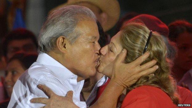 Salvador Sanchez Ceren, the presidential candidate for the Farabundo Marti National Liberation Front (FMLN), kisses his wife Margarita Villalta in San Salvador on 15 March, 2014