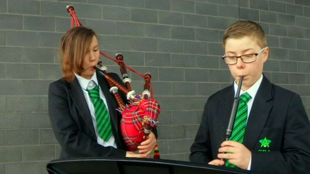 Students playing bagpipes and pipe