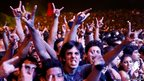 Fans of Metallica flash signs