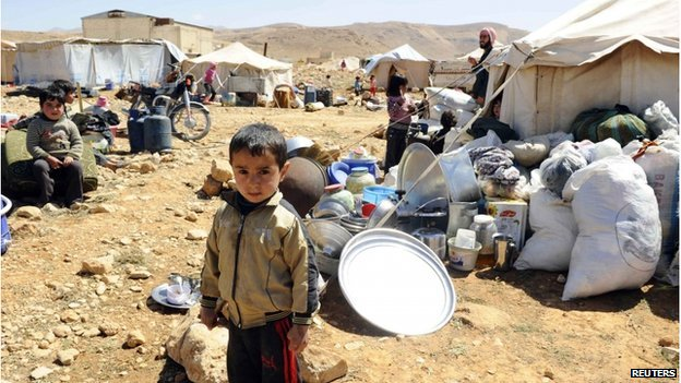 A child stands in a refugee camp
