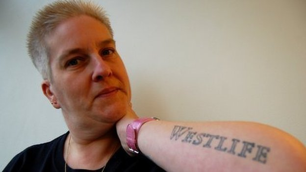 Westlife fan Jane Fogg displays one of her tattoos