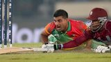 Ziaur Rahman of Bangladesh reacts after missing the stumps