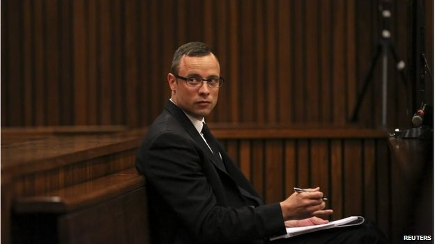 Olympic and Paralympic track star Oscar Pistorius sits in the dock during his trial in Pretoria on 25 March
