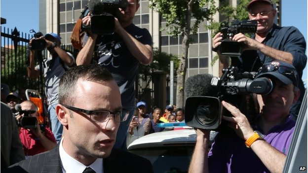 Oscar Pistorius outside the court, surrounded by broadcast media crews