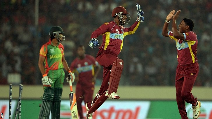 West Indies wicketkeeper Denesh Ramdin (centre) celebrates
