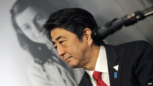 Japanese Prime Minister Shinzo Abe visits the Anne Frank museum in Amsterdam on March 23, 2014.