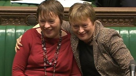 Angela and Maria Eagle share a hug in the Commons