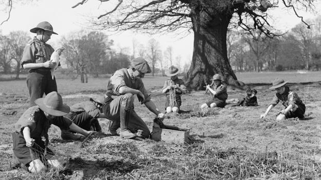 Boy scouts helping to set rabbit traps