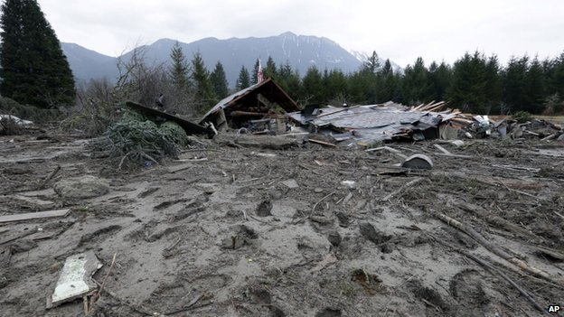 Footprints from searchers remain in mud at the edge of a deadly mudslide in Oso, Washington, on 25 March 2014