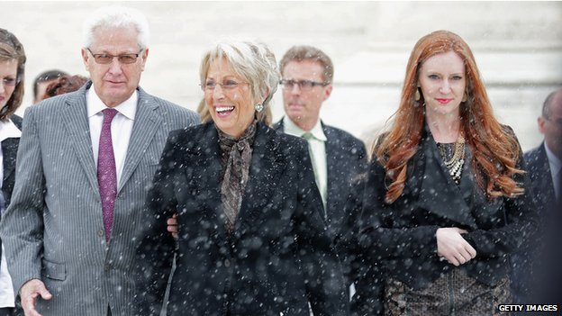 Hobby Lobby co-founders David Green (L) and Barbara Green (C) leave the U.S. Supreme Court after oral arguments in Sebelius v Hobby Lobby