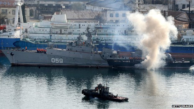 A Russian navy anti-submarine warship, the Aleksandrovets, prepares to make its way in the bay of the Crimean city of Sevastopol on 25 March 2014