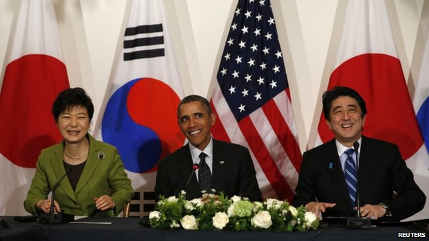 US President Barack Obama participates seen with President Park Geun-hye of the South Korea and Prime Minister Shinzo Abe of Japan after a meeting between the three leaders at the nuclear security summit in The Hague on 25 March 2014