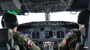 This 24 March 2014 US Navy handout image shows naval aviators assigned to Patrol Squadron (VP) 16, piloting a P-8A Poseidon over the Indian Ocean during a mission to assist in search and rescue operations for Malaysia Airlines flight MH370