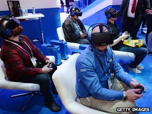 Gamers play with Oculus Rift