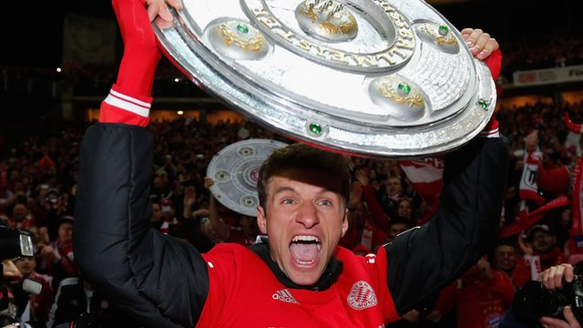 Bayern Munich's Thomas Mueller celebrates Bundesliga title