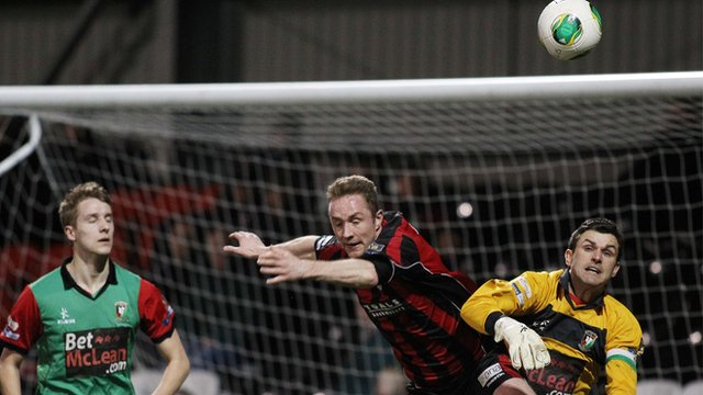 Crusaders striker Timmy Adamson and Glentoran keeper Elliott Morris challenge for the ball