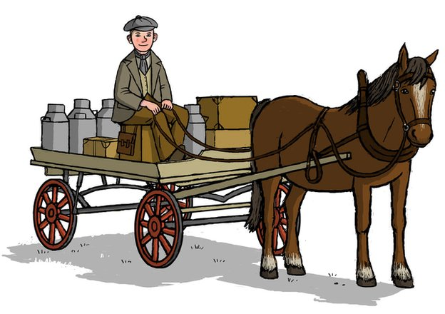 A man at the reigns of a horse and cart