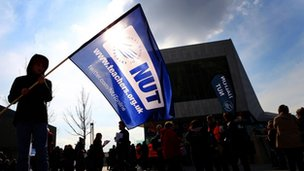 A young boy in Liverpool's Mann Island holds aloft a flag in support for the Nation Union of Teachers