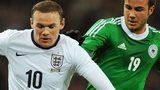England's Wayne Rooney battles for possession with Mario Gotze of Germany at Wembley in November 2013