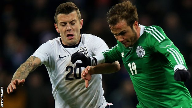 England's Jack Wilshere battles for possession with Mario Gotze of Germany at Wembley in November 2013