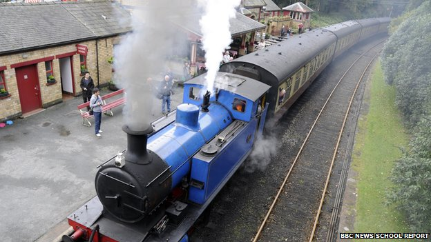 Blue Steam engine in station
