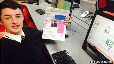 School Reporter Ryan holding a copy of his newspaper