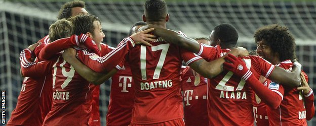 Bayern Munich's players celebrate winning the Bundesliga title