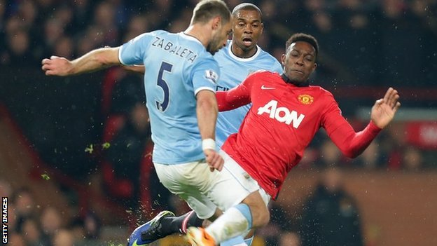 Danny Welbeck tackles Pablo Zabaleta
