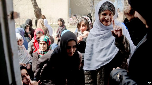Afghan women queue to register to vote, Kabul (19 March)