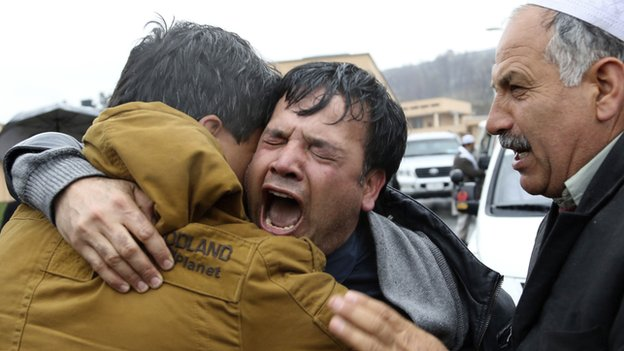Sardar's brother, Bashir Ahmad cries during the funeral ceremony in Kabul