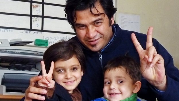 Sardar Ahmad poses for a photograph with his daughter Nilofar and son Omar at the AFP office in Kabul in 2012