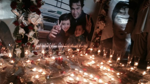 Journalists remember Sardar Ahmad and his family at a candlelight vigil in Kabul
